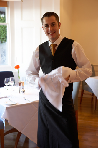 Waiter polishing Glasses @ ABode Hotel Exeter